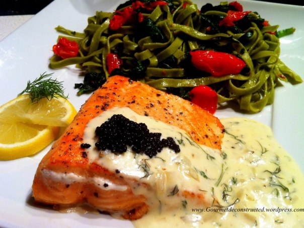 Baked Salma Salmon with Dill/Parmesan Sauce served with Spinach Fettuccine Tossed with Fresh Spinach and Mini San Marzano Tomatoes & Lumpfish Roe.