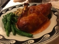 Roasted Half Duck With sundried cherry merlot sauce served with roasted poblano black bean rice and seasonal vegetables